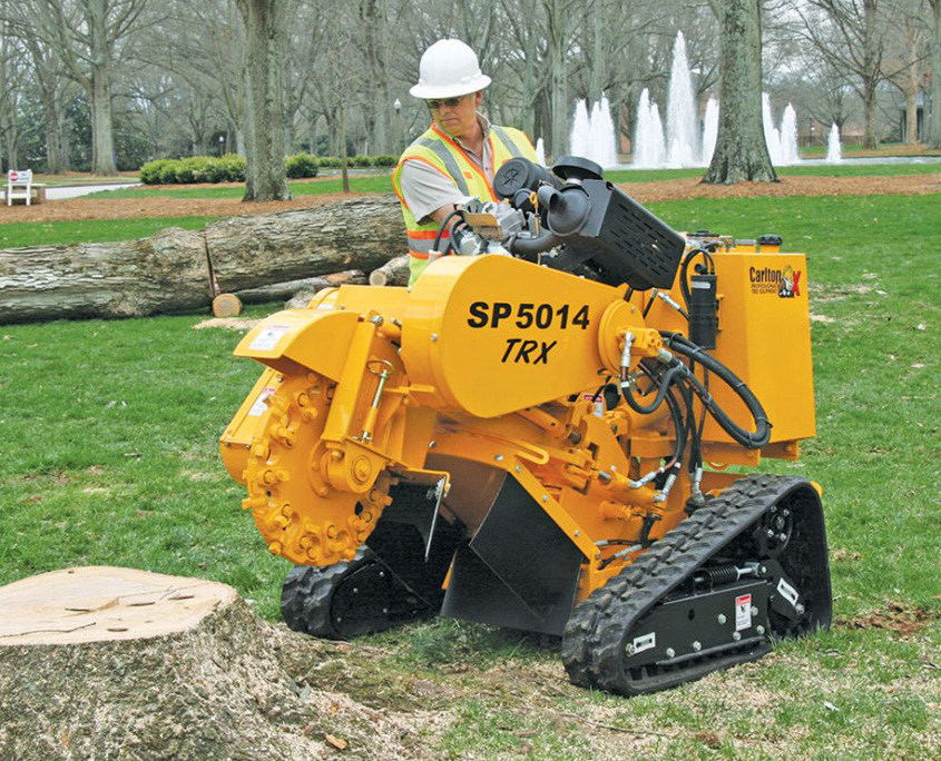 a man grinding a stump